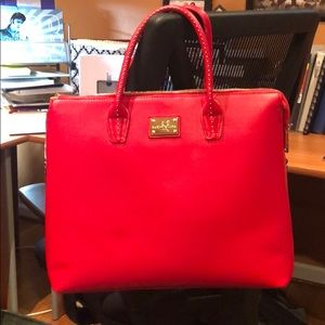 Red laptop work bag with gold detailing